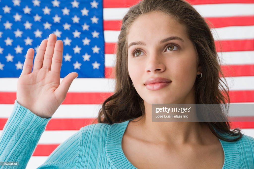 Hispanic teenaged girl in front of American flag : Stock Photo