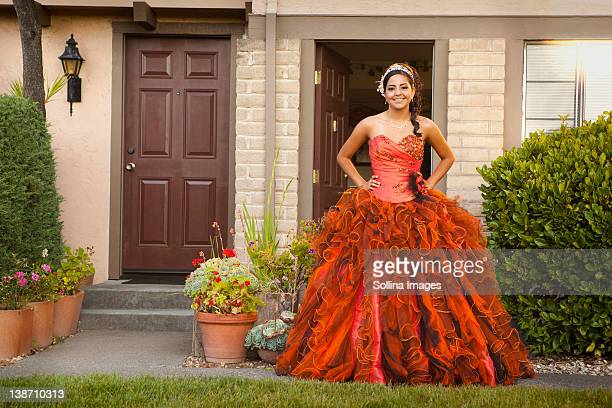 hispanic teenager dressed for quinceanera - quinceanera stock pictures, royalty-free photos & images