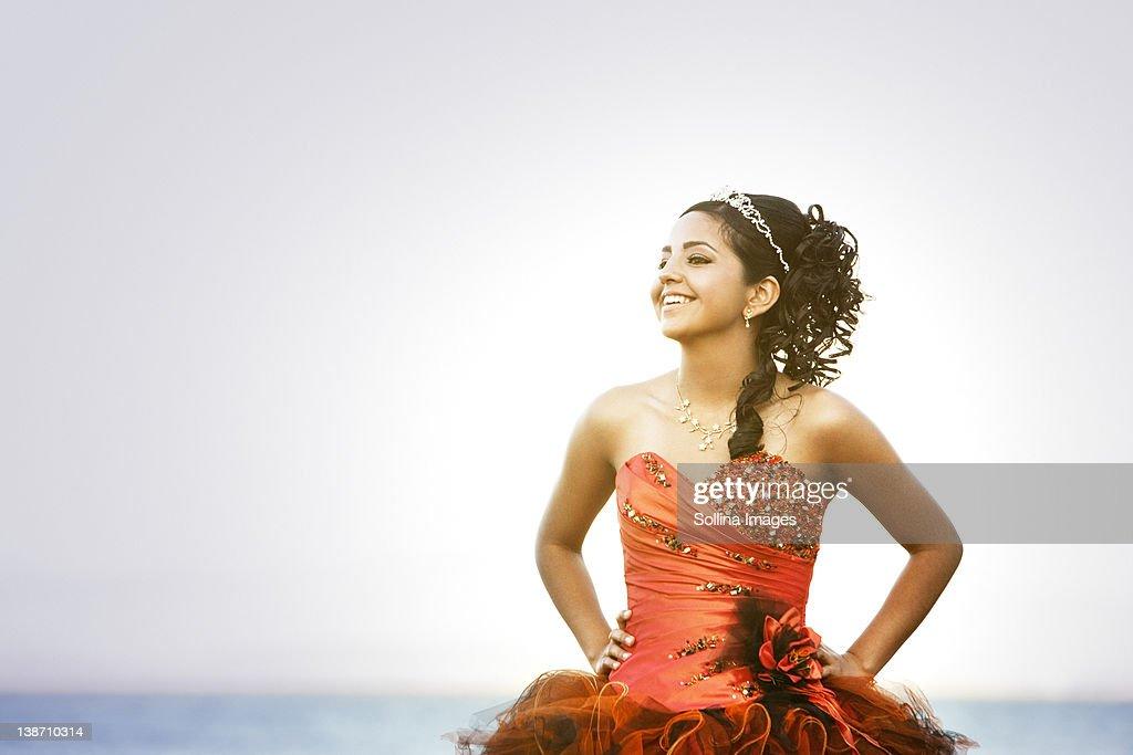 Hispanic teenager dressed for quinceanera : Stock Photo