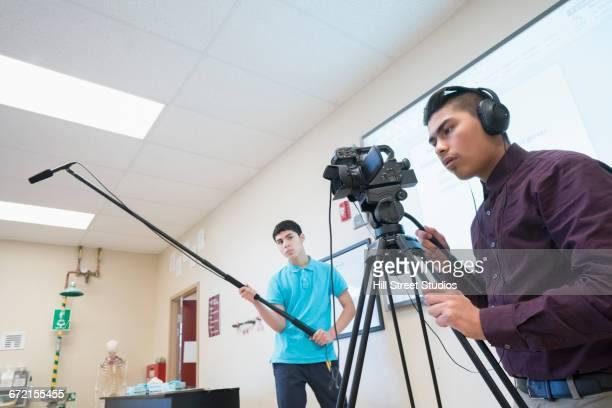 Hispanic video recording crew in classroom