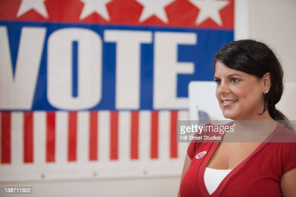 hispanic voter standing in polling place - gardena california stock pictures, royalty-free photos & images