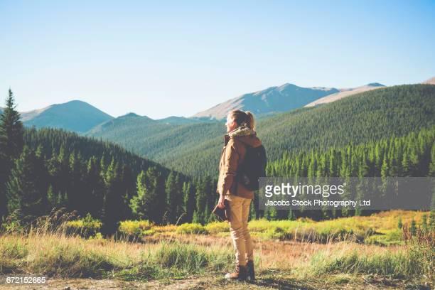 Hispanic woman admiring mountains, Breckenridge, Colorado, United States,