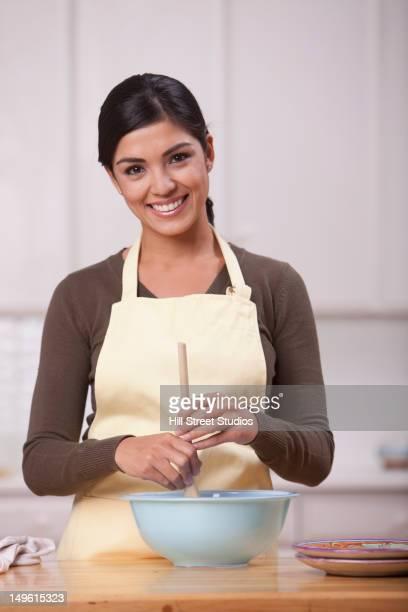 hispanic woman baking in kitchen - gardena california stock pictures, royalty-free photos & images