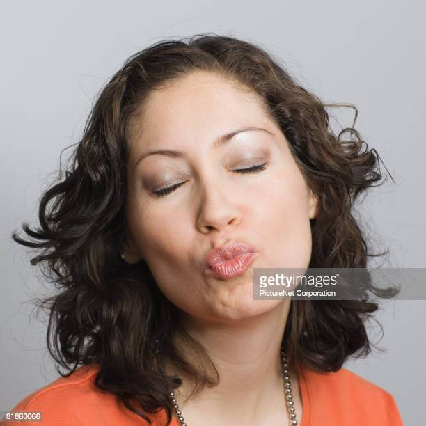 Hispanic woman blowing kiss