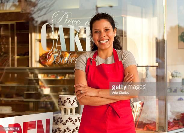Hispanic woman business owner outside shop