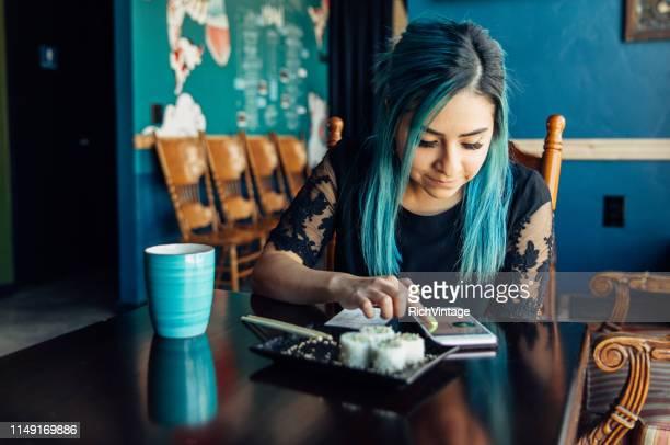 Hispanic Woman Checking Finances at Lunch