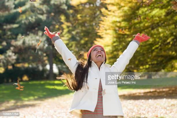 Hispanic woman cheering in park