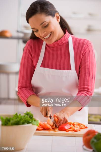 hispanic woman chopping tomatoes - puerto rican ethnicity stock pictures, royalty-free photos & images