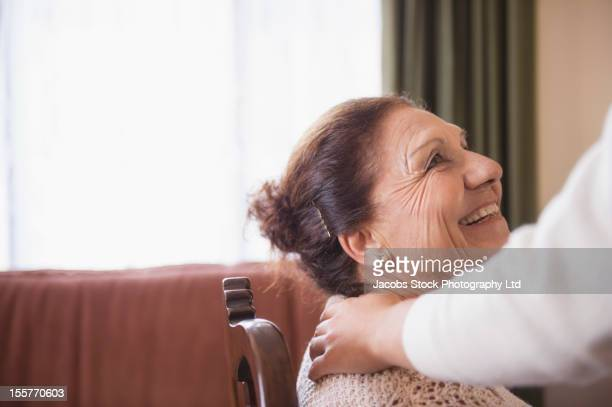 Hispanic woman comforting senior woman