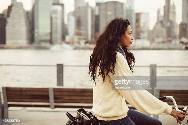 Hispanic woman commuting on Bicycle in NYC