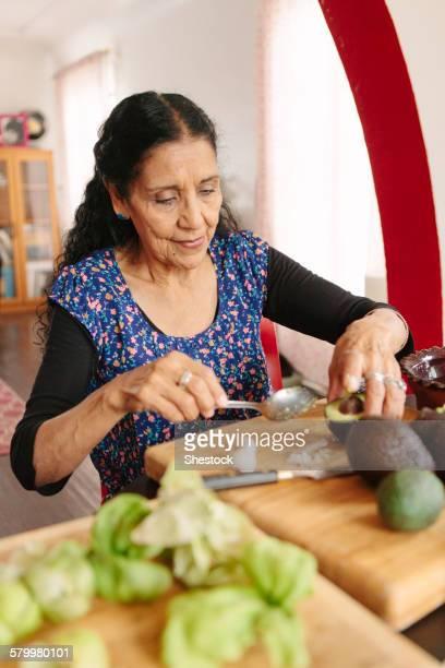 Hispanic woman cooking in kitchen