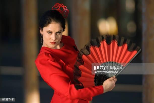 hispanic woman flamenco dancing - フラメンコ ストックフォトと画像