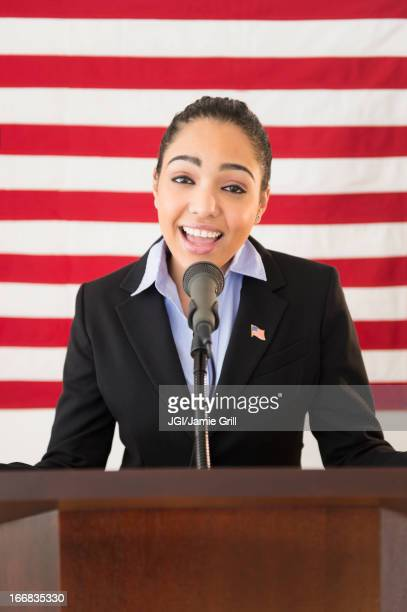 hispanic woman giving speech - american influenced stock photos and pictures