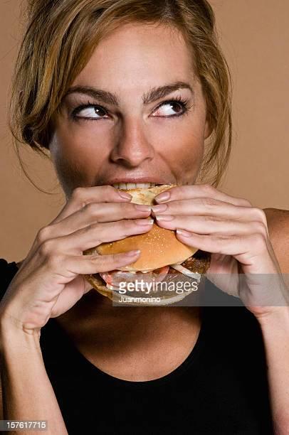 Hispanic Woman Having a Hamburger
