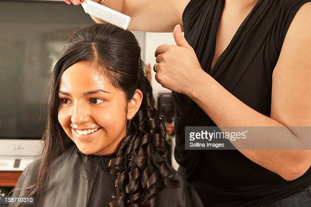 hispanic woman having hair styled in salon - quinceanera stock pictures, royalty-free photos & images