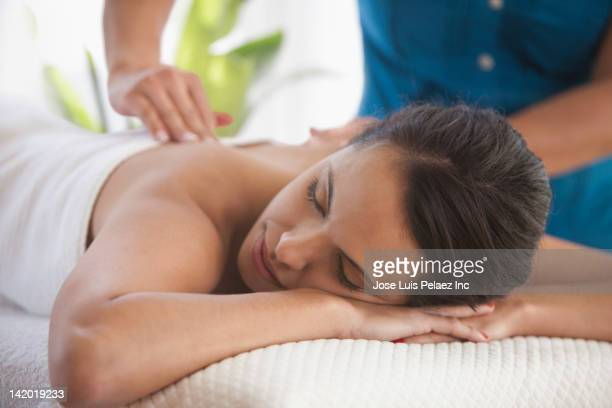 hispanic woman having massage - massage therapist stock pictures, royalty-free photos & images