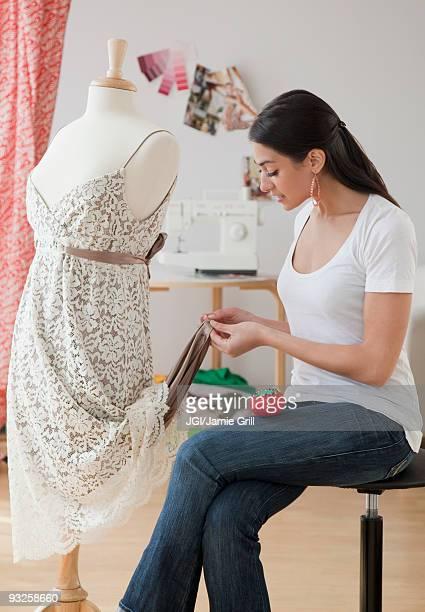 hispanic woman hemming dress - 裾 ストックフォトと画像