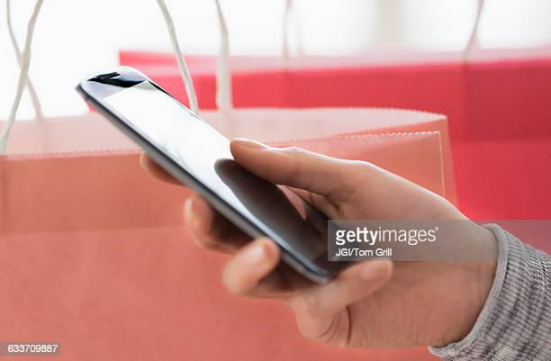 Hispanic woman holding cell phone