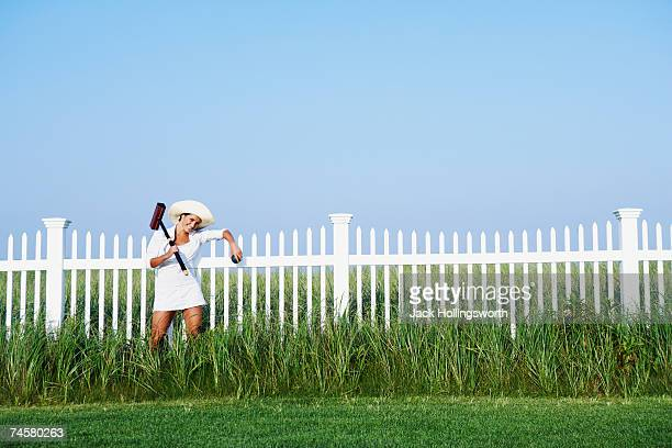 hispanic woman holding croquet mallet - mallet hand tool stock pictures, royalty-free photos & images