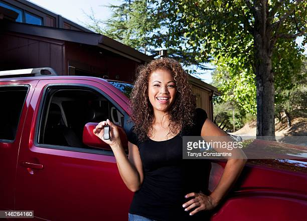 hispanic woman holding keys to new car - fairfax california stock pictures, royalty-free photos & images