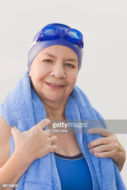 Hispanic woman in bathing suit with towel