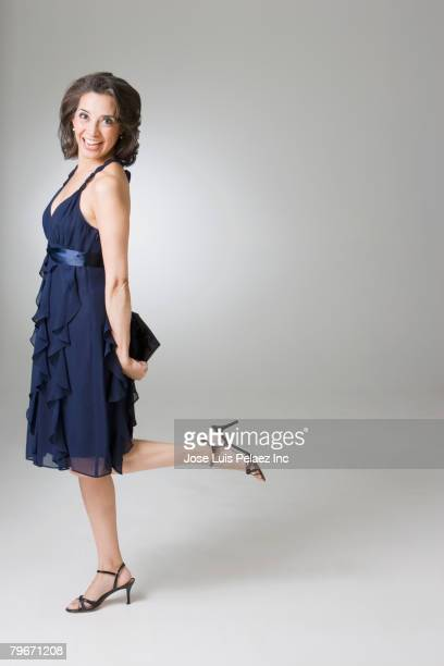 hispanic woman in evening dress - evening gown stock photos and pictures