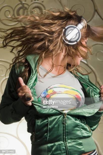 Hispanic woman in headphones dancing