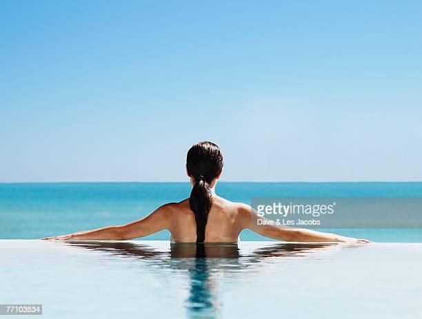Hispanic woman in swimming pool