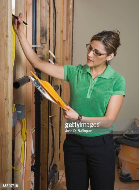 Hispanic woman inspecting construction job