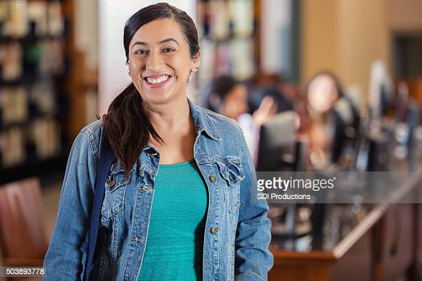 Hispanic woman is adult college student continuing education