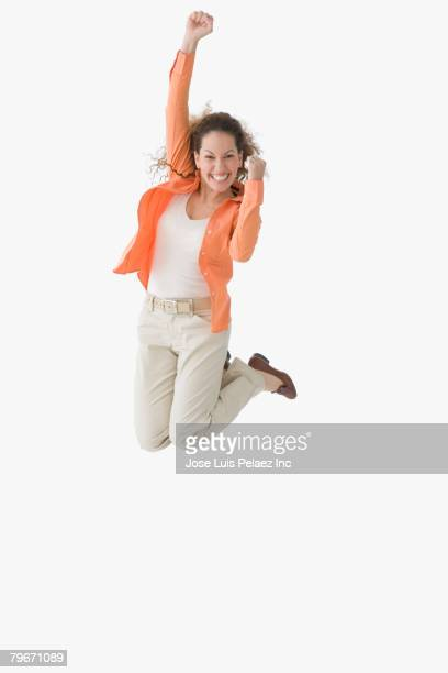 Hispanic woman jumping and cheering