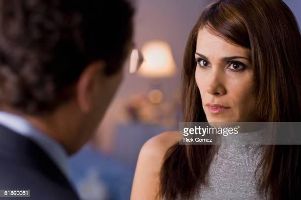 Hispanic woman looking at husband