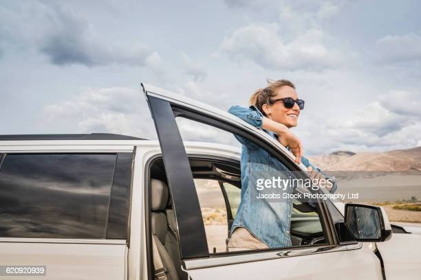 Hispanic woman looking out from car