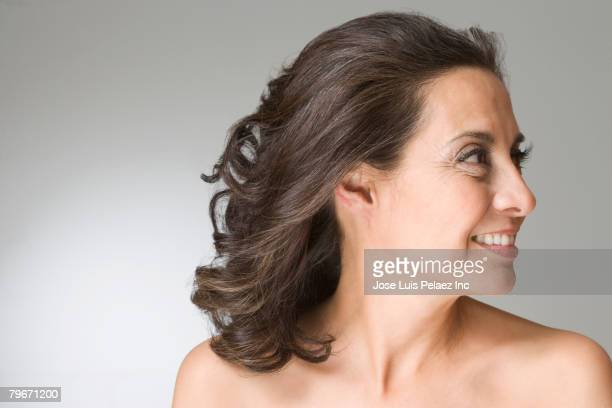 Hispanic woman looking to side