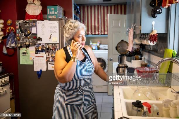 Hispanic Woman Making Dinner in Kitchen