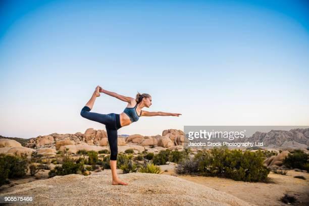 hispanic woman performing yoga in desert - san bernardino california stock pictures, royalty-free photos & images