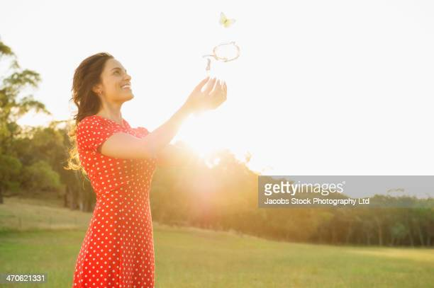 hispanic woman playing outdoors - releasing stock photos and pictures