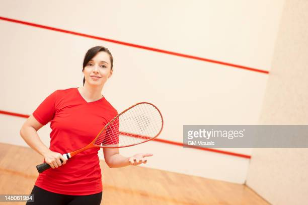 hispanic woman playing racquetball - racquet stock pictures, royalty-free photos & images