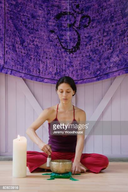 Hispanic woman practicing religious ritual