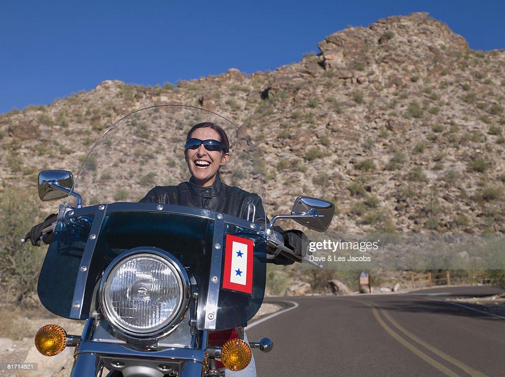 Hispanic woman riding motorcycle : Stock Photo