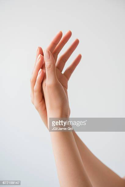 Hispanic woman rubbing hands
