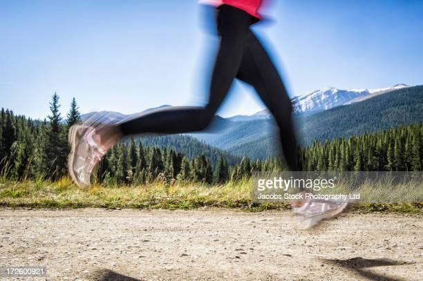 Hispanic woman running on dirt path