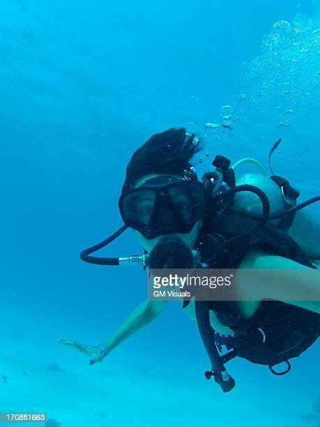 Hispanic woman scuba diving