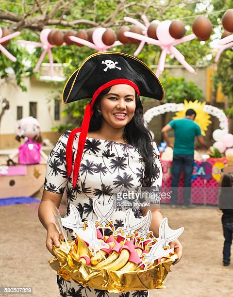 hispanic woman serving snacks at party - mexican fiesta stock pictures, royalty-free photos & images