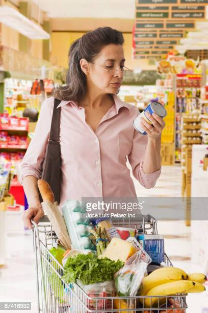 Hispanic woman shopping in grocery store