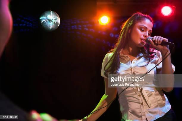 hispanic woman singing in nightclub - sångare artist bildbanksfoton och bilder