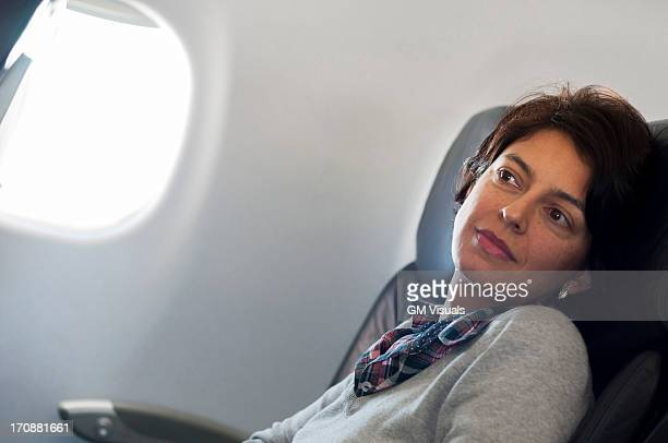 Hispanic woman sitting in airplane