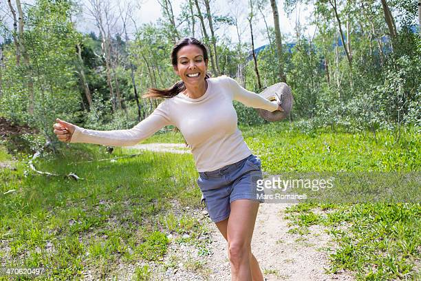hispanic woman skipping in forest - skipping along stock pictures, royalty-free photos & images