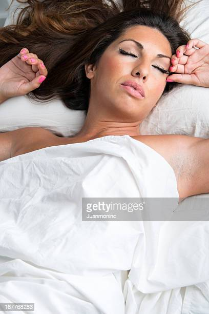 hispanic woman sleeping in bed - women with large breast stock pictures, royalty-free photos & images