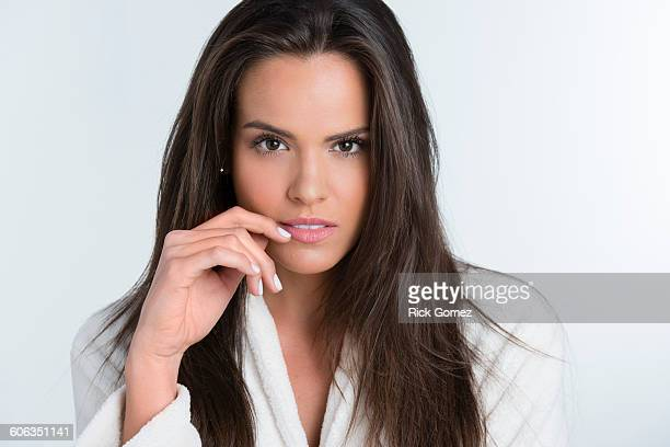 Hispanic woman smiling in bathrobe